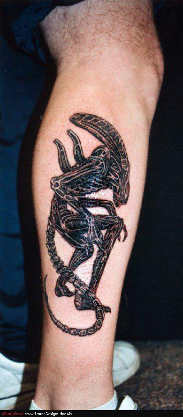 Black Ink Alien Tattoo On Leg