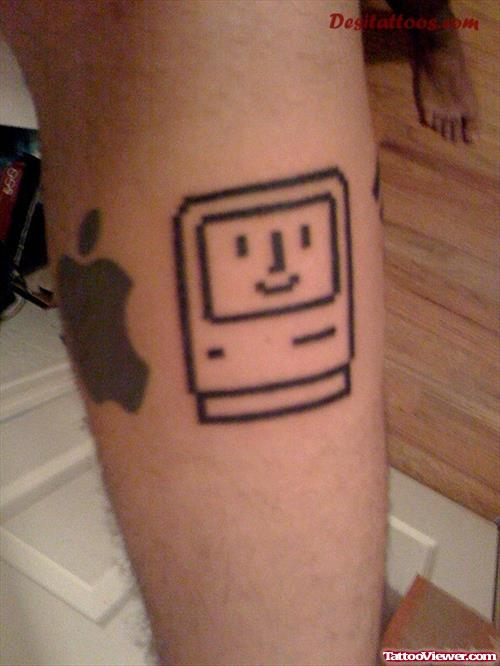 Robo And Apple Tattoo On Leg