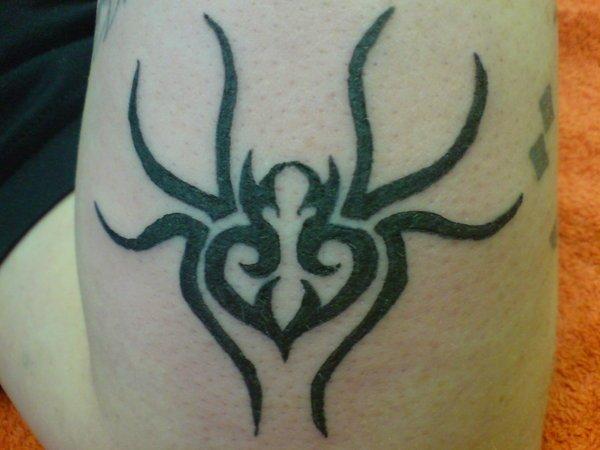 Black Tribal Apple Tattoo On Bicep
