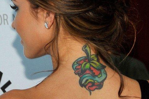 Snake And Apple Tattoo On Girl Upperback