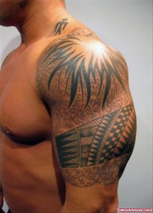 Wonderful Black Ink Tribal Tattoo On Man Left Arm