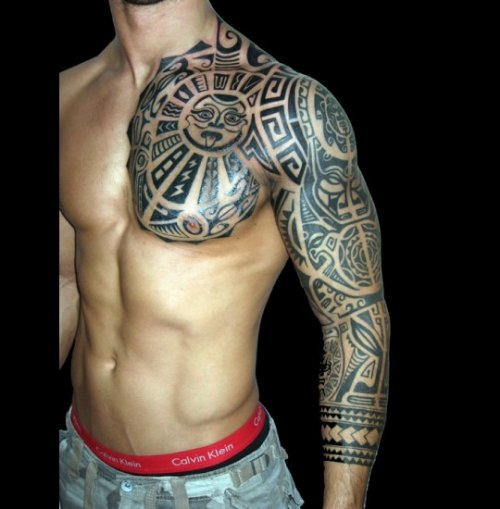 Maori Tattoo On Man Chest And Left Sleeve