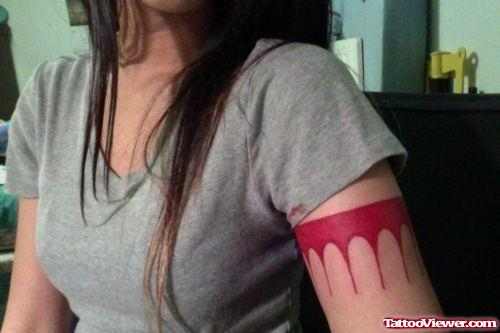 Melting Red Armband Tattoo On Girl Left Bicep
