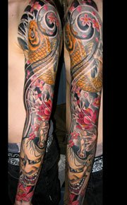 colored Asian Tattoo On Man Left Sleeve