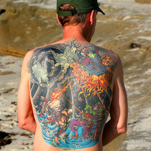 Attractive Colored Asian Tattoo On Man Back