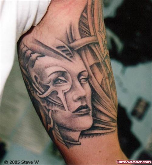 Face Tattoo On Biceps