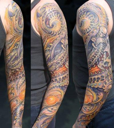 Colored Ink Biomechanical Tattoo On Left Sleeve