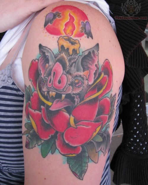 Flowers And Burning Candle Tattoo