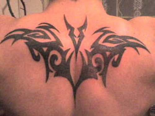 Tribal And Capricorn Tattoo On Upperback
