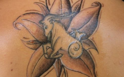 Grey Ink Flower And Capricorn Tattoo