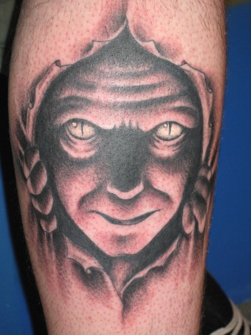 Ripped Skin Devil Face Tattoo On Leg