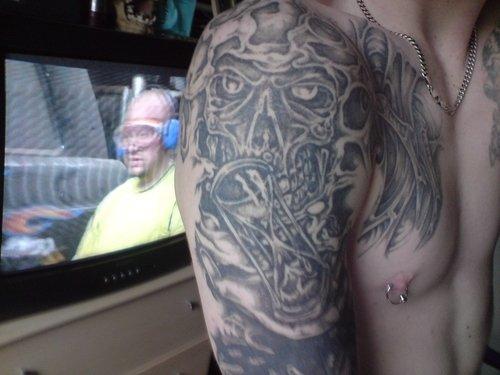Grey Ink Skull And Hourglass Devil Tattoo