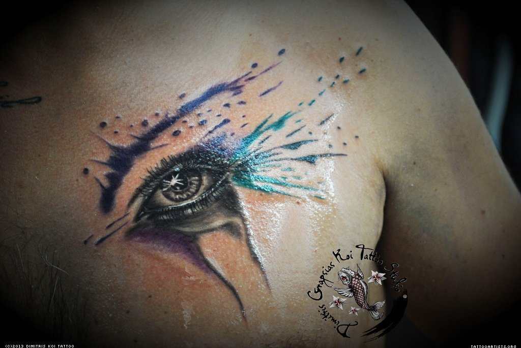 Abstarct Colored Eye Tattoo On Back Shoulder