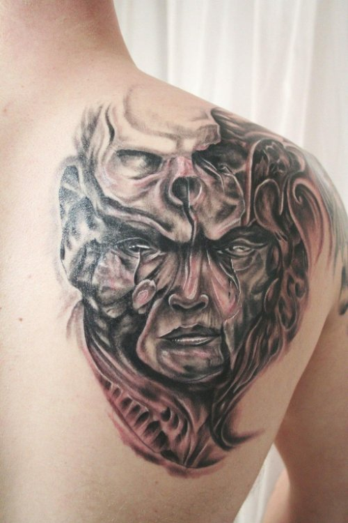 Grey Ink Scary Face Tattoo On Right Back Shoulder
