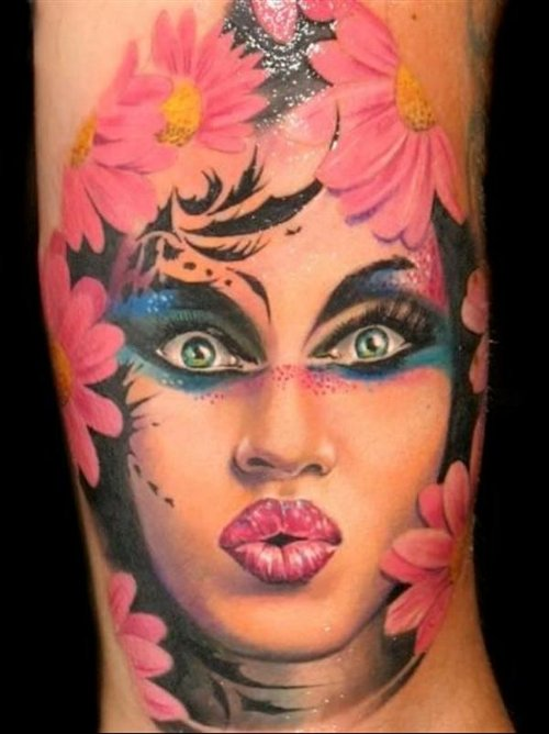 Pink Flowers And Women Face Tattoo