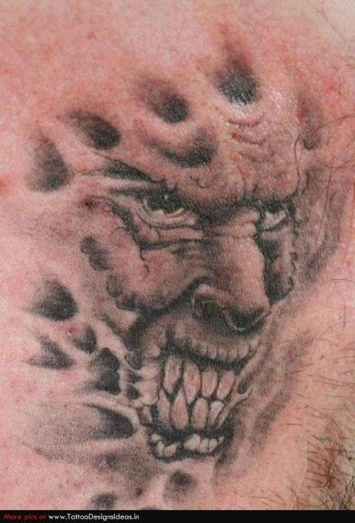 Grey Ink Demon Face Tattoo