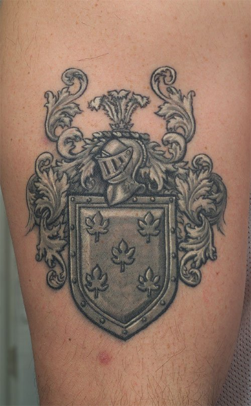 Grey Ink Family Crest Tattoo On Sleeve