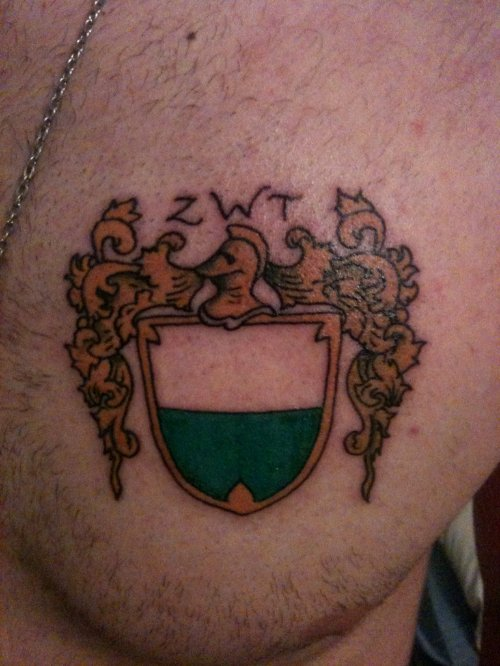 Color Family Crest Tattoo On Man Chest