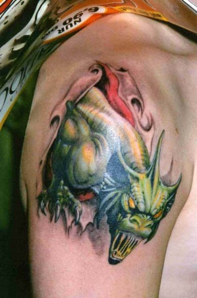 Green Ink Fantasy Tattoo On Shoulder