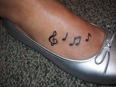 Music Notes Feminine Tattoo On Girl Foot