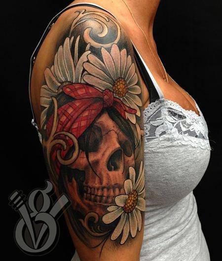 Grey Ink Skull And Feminine Flowers Tattoo