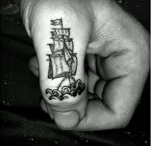 Grey Ink Ship Finger Tattoo