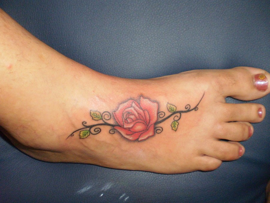 Red Ink Rose Flower Tattoo On Girl Right Foot