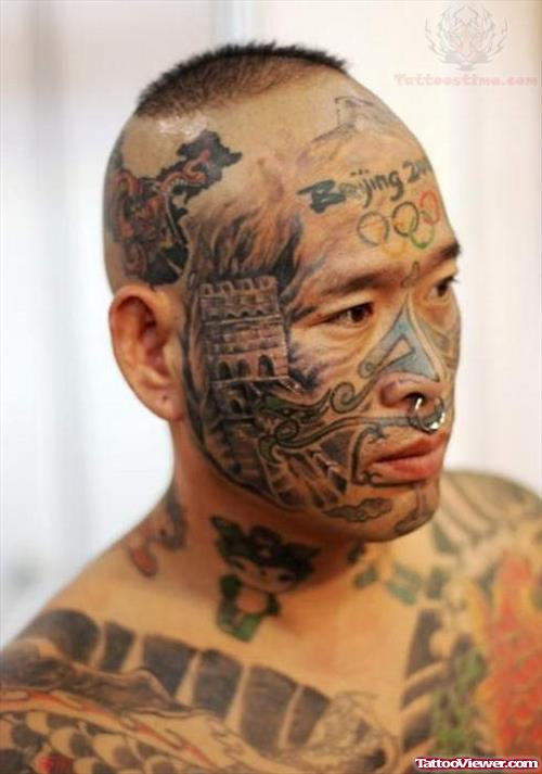 Face And Beijing Tattoo On Forehead