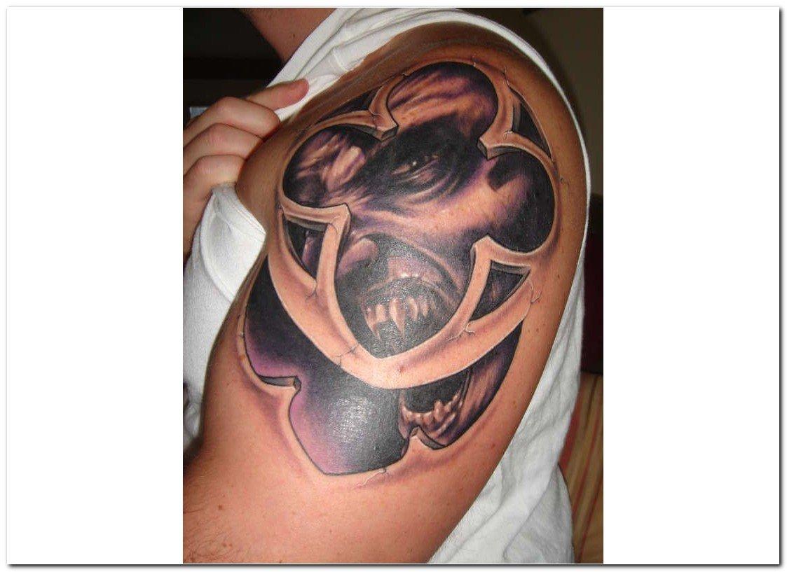 Grey Ink Gothic Tattoo On Man Left Sleeve