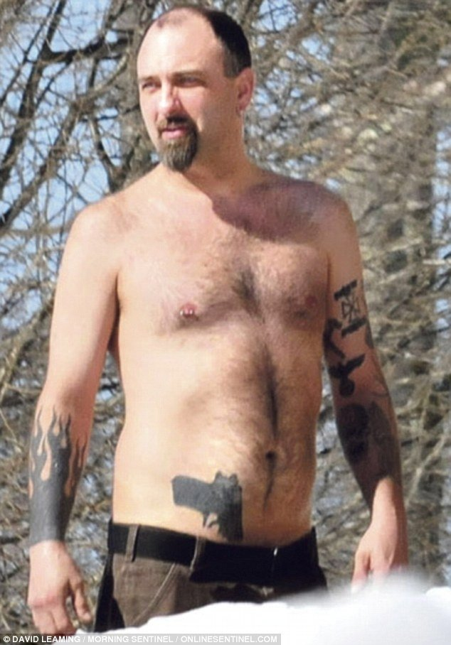 Man With Gun Tattoo On Hip