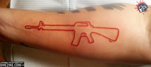 Red Ink Outline Gun Tattoo