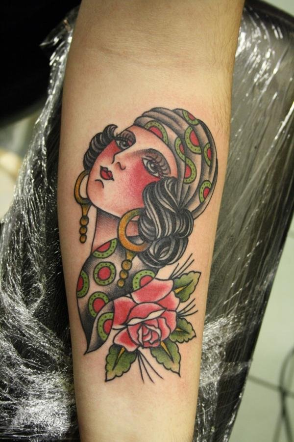 Pink Rose And Gypsy Head Tattoo On Arm