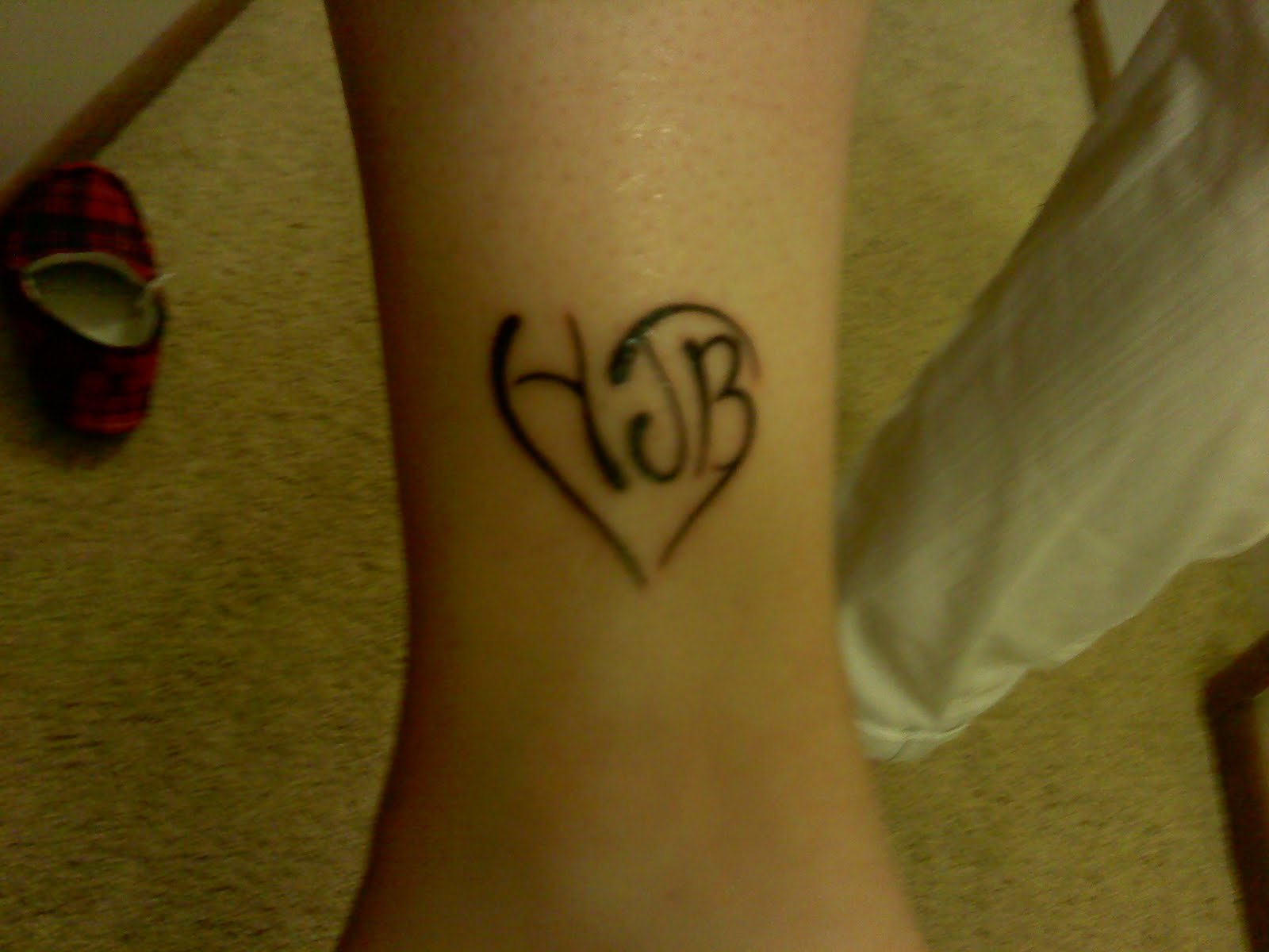 Black Ink Heart Tattoo On Leg