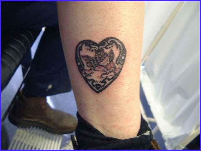 Grey Ink Cherub Angel Heart Tattoo On Leg