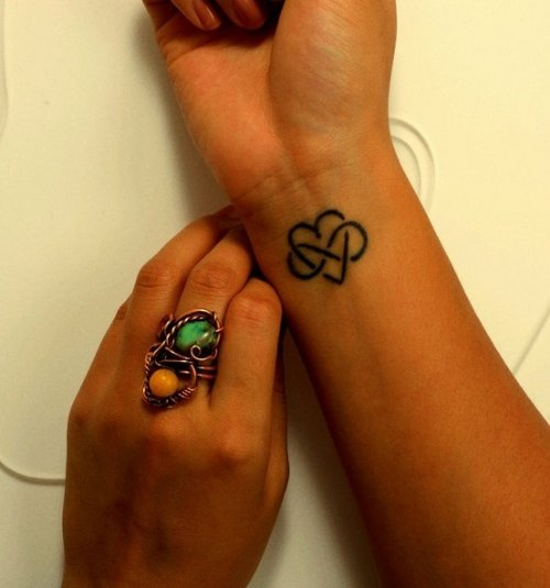 Infinity Symbol And Heart Tattoo On Right Wrist