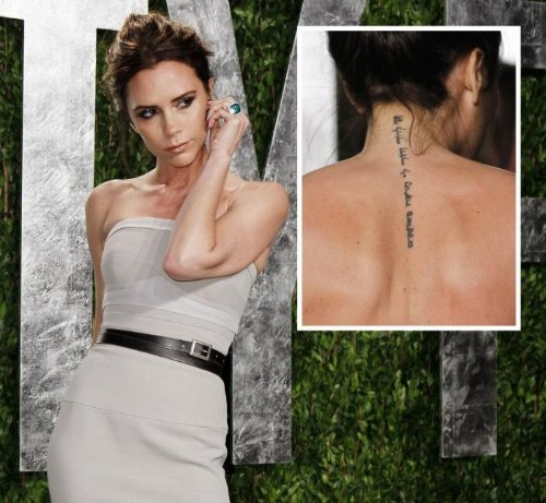 Attractive Hebrew Tattoo On Upperback
