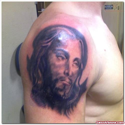 Jesus Face Tattoo On Upper Shoulder