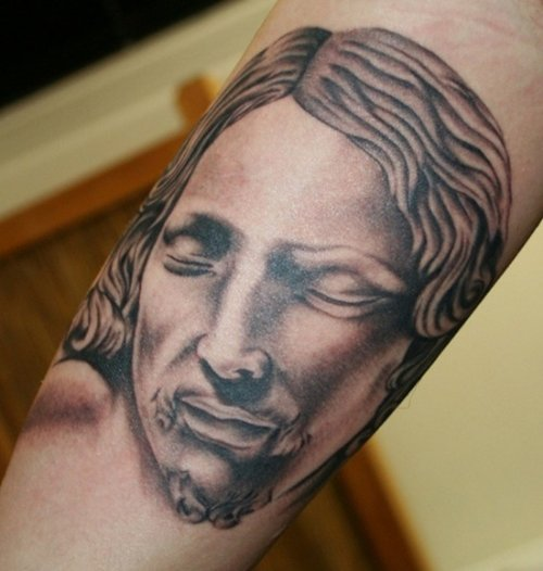 Grey Ink Jesus Tattoo On Bicep
