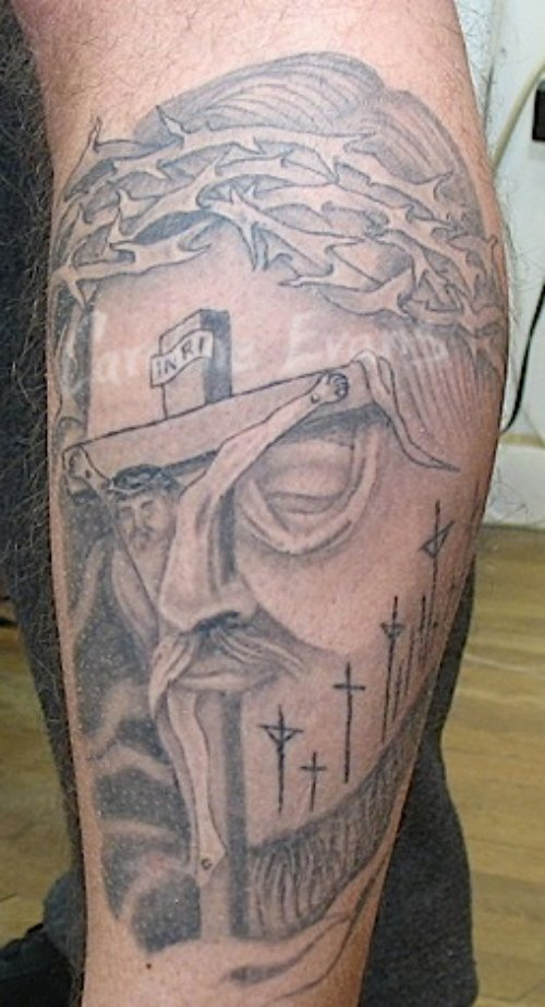 Grey Ink Cross And Jesus Head Tattoo On Sleeve