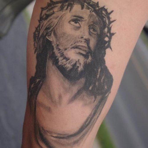 Attractive Grey Ink Jesus Tattoo On Sleeve