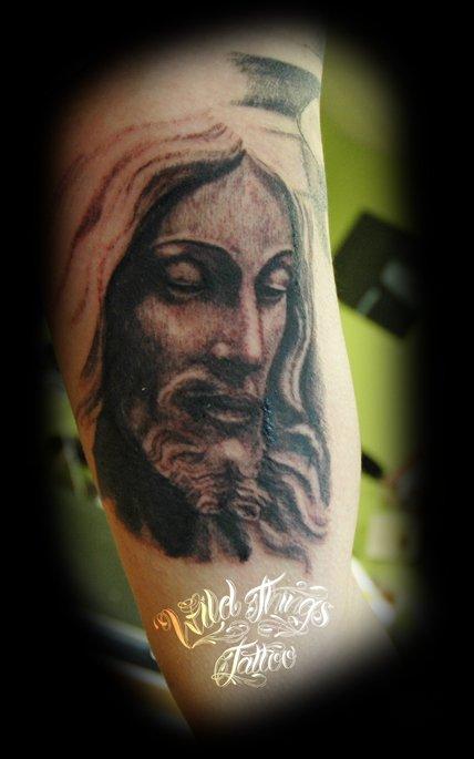 Grey Ink Jesus Christ Tattoo On Right Sleeve
