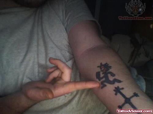 Juggalo And Cross Tattoo On Arm