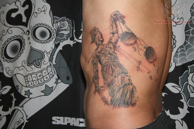 Justice Tattoo On Man Left Rib side