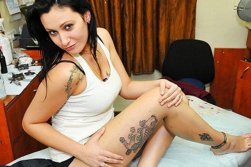 Grey Ink Flowers And Koi Leg Tattoo