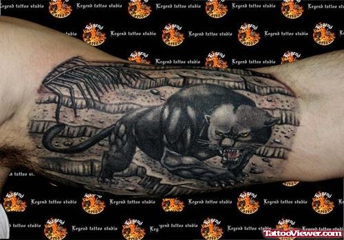 Dark Ink Panther Tattoo On Inner Bicep