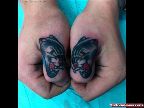Panther Head Tattoos On Both Thumbs
