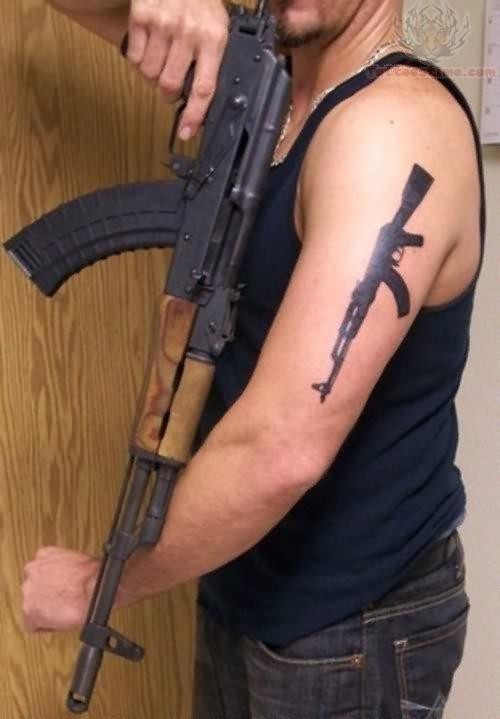 Gun Tattoo On Biceps