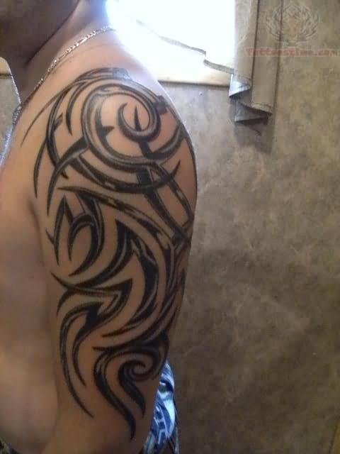 Awesome Tribal Tattoo On Half Sleeve