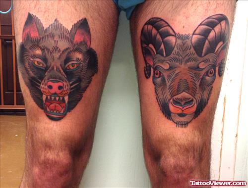 Colored Wolf Heads Tattoos On Thigh
